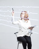 Doctor woman drawing cardiogram Stock Photography