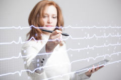 Doctor woman drawing cardiogram Royalty Free Stock Image