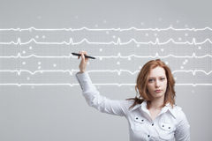 Doctor woman drawing cardiogram Stock Photography
