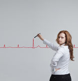 Doctor woman drawing cardiogram Royalty Free Stock Images