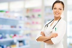 Doctor woman in drug store Royalty Free Stock Photos