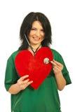 Doctor woman examine heart shape Stock Photography