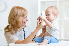 Doctor woman examining child boy with stethoscope Royalty Free Stock Image