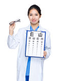 Doctor woman with eye chart and glasses Stock Photography