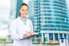 doctor woman filling out prescription Royalty Free Stock Photo