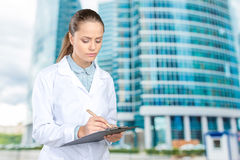 Doctor woman filling out prescription Stock Photography