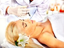 Free Doctor Woman Giving Botox Injections. Royalty Free Stock Photos - 34069368