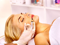 Doctor woman giving botox injections. Royalty Free Stock Photography