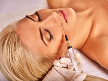 Doctor woman giving botox injections Royalty Free Stock Photos