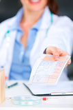 Doctor woman giving medical prescription. Closeup. Royalty Free Stock Image