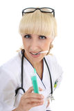 Doctor woman in gown with syringe over white Stock Photo
