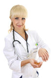 Doctor woman in gown with tablets Stock Photos