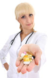 Doctor woman in gown with tablets. focus on hand Stock Photos