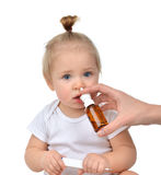 Doctor Woman hand using medicine nose spray nasal for baby toddl Royalty Free Stock Photo