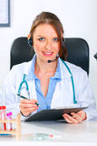 Doctor woman with headset holding clipboard Royalty Free Stock Photos