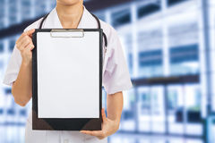 Doctor woman hold blank working board Stock Photo