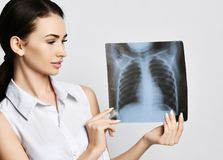 Doctor woman hold lungs X-ray examination of patient chest on gray. Background stock images