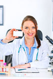 Doctor woman holding blank business card Stock Photography