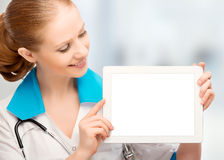 Doctor woman holding a blank white tablet computer. Doctor woman holding a blank empty white tablet computer Royalty Free Stock Photo