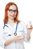 The doctor woman holding a container of vitamins Stock Images