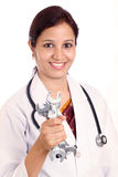 Doctor woman holding spanners Royalty Free Stock Images