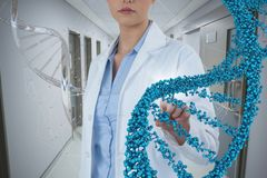 Doctor woman interacting with 3D DNA strand. Digital composite of Doctor woman interacting with 3D DNA strand royalty free stock photos
