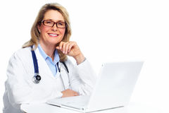 Doctor woman with laptop computer. Stock Photo