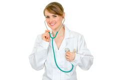 Doctor woman listening to heart with stethoscope Stock Images
