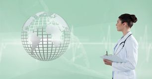 Doctor (woman) looking 3D metallic earth Royalty Free Stock Photos