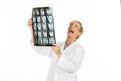 Doctor woman looking at patient x-rays Royalty Free Stock Photo