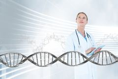 Doctor woman looking up with 3D DNA strand. Digital composite of Doctor woman looking up with 3D DNA strand Royalty Free Stock Images