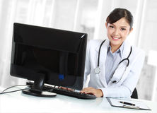 Doctor woman in the office. Beautiful medical doctor woman in the office Stock Photo