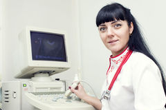 Doctor. Woman in the office of ultrasound Stock Photo