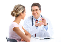 Doctor and woman patient Royalty Free Stock Photo