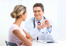 Doctor and woman patient Royalty Free Stock Images