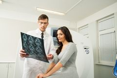 Doctor with woman patient  at computed tomography Stock Photo