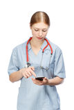 Doctor woman with phone Stock Photos