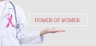 Doctor woman with pink ribbon on chest. supporting symbol of breast cancer awareness and international women day campaign.  stock image