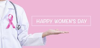 Doctor woman with pink ribbon on chest. supporting symbol of breast cancer awareness and international women day campaign.  stock images