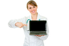 Doctor woman pointing on laptop with blank screen Stock Images
