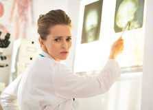 Doctor woman pointing on lightbox Stock Photos