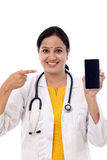 Doctor woman pointing on smart phone screen Stock Photo
