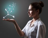 Doctor woman present molecule chain. Doctor woman present molecule chain over gray background Royalty Free Stock Image