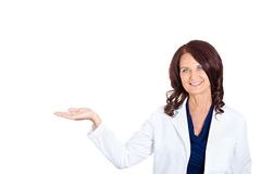 Doctor woman presenting and showing copy space Royalty Free Stock Photography