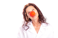 Doctor woman with red clown nose Royalty Free Stock Photo
