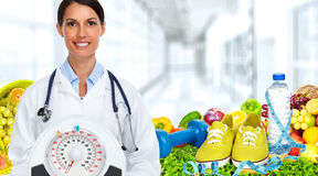Doctor woman with scales. Royalty Free Stock Photography