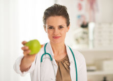 Doctor woman showing apple Royalty Free Stock Image