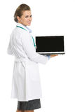 Doctor woman showing laptop blank screen. Isolated on white stock photos