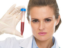Doctor woman showing test tube Royalty Free Stock Image