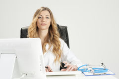 Doctor Woman Sitting On Her Desk Stock Photo